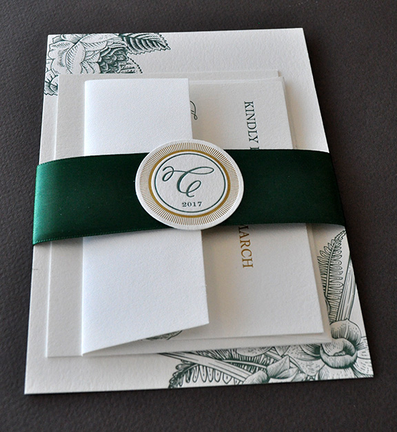 Elegant botanical theme for letterpress wedding invitation suite with band and monogram medalion