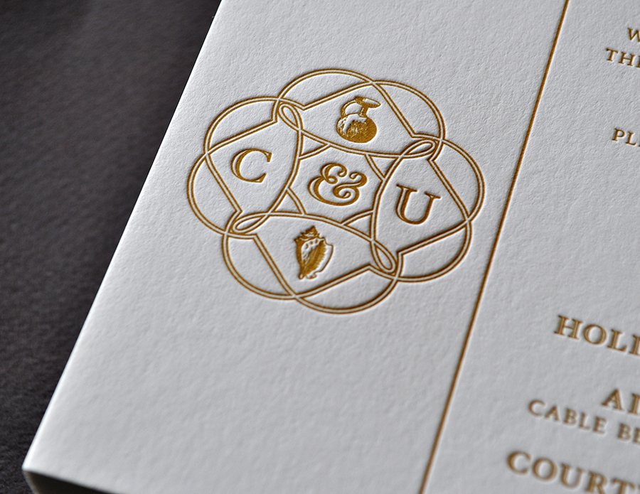 Distinctive gold ink letterpress wedding invitation