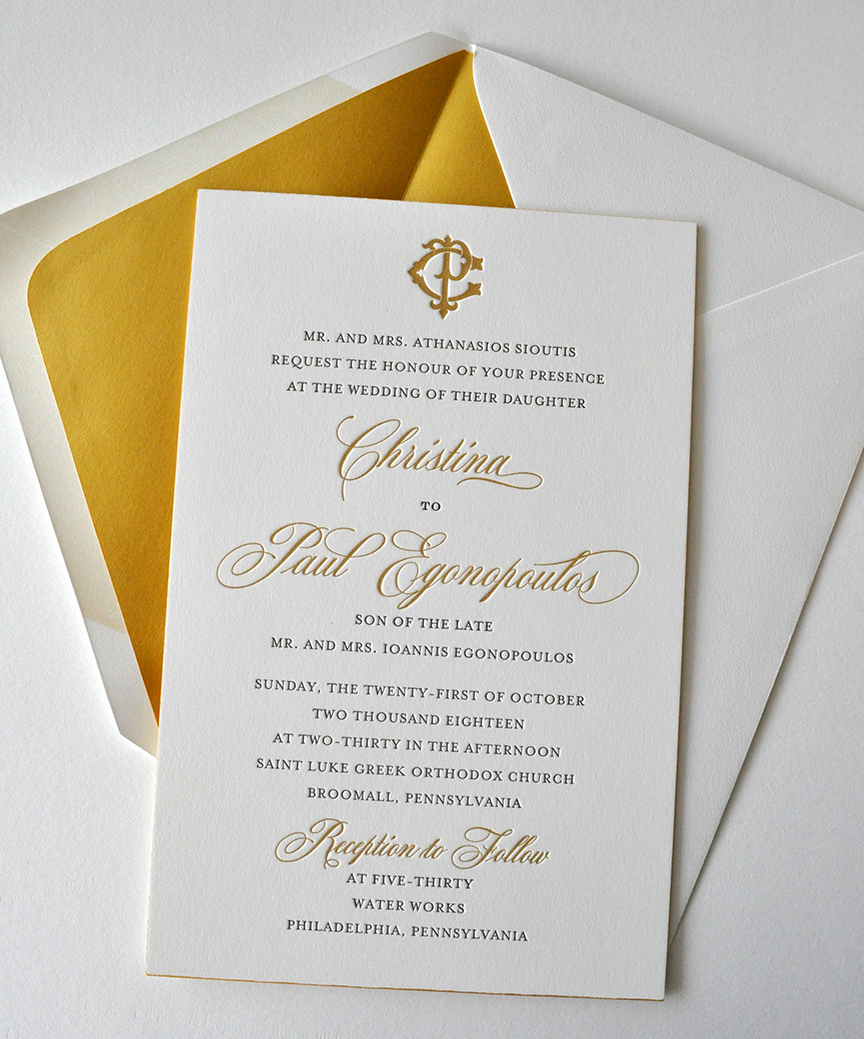 sophisticated letterpress wedding invitation suite in gold