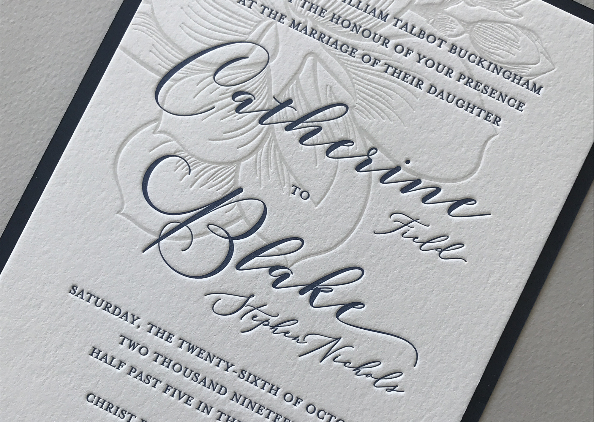 Two color custom invitation printed on 220# Crane's Lettra pearl, mounted on Gmund Imperial Blue