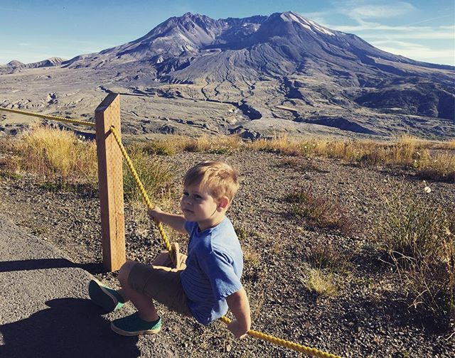 Small boy. Big volcanic mountain.