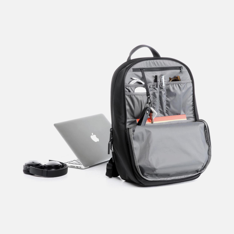 Toolbox-inspired design keeps bag upright.