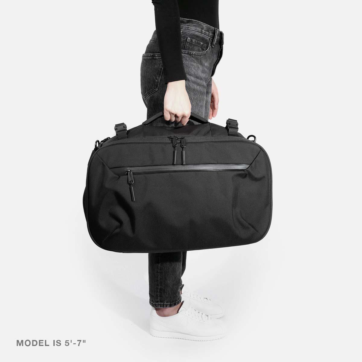 21014_travelduffel_black_model_f1.jpg