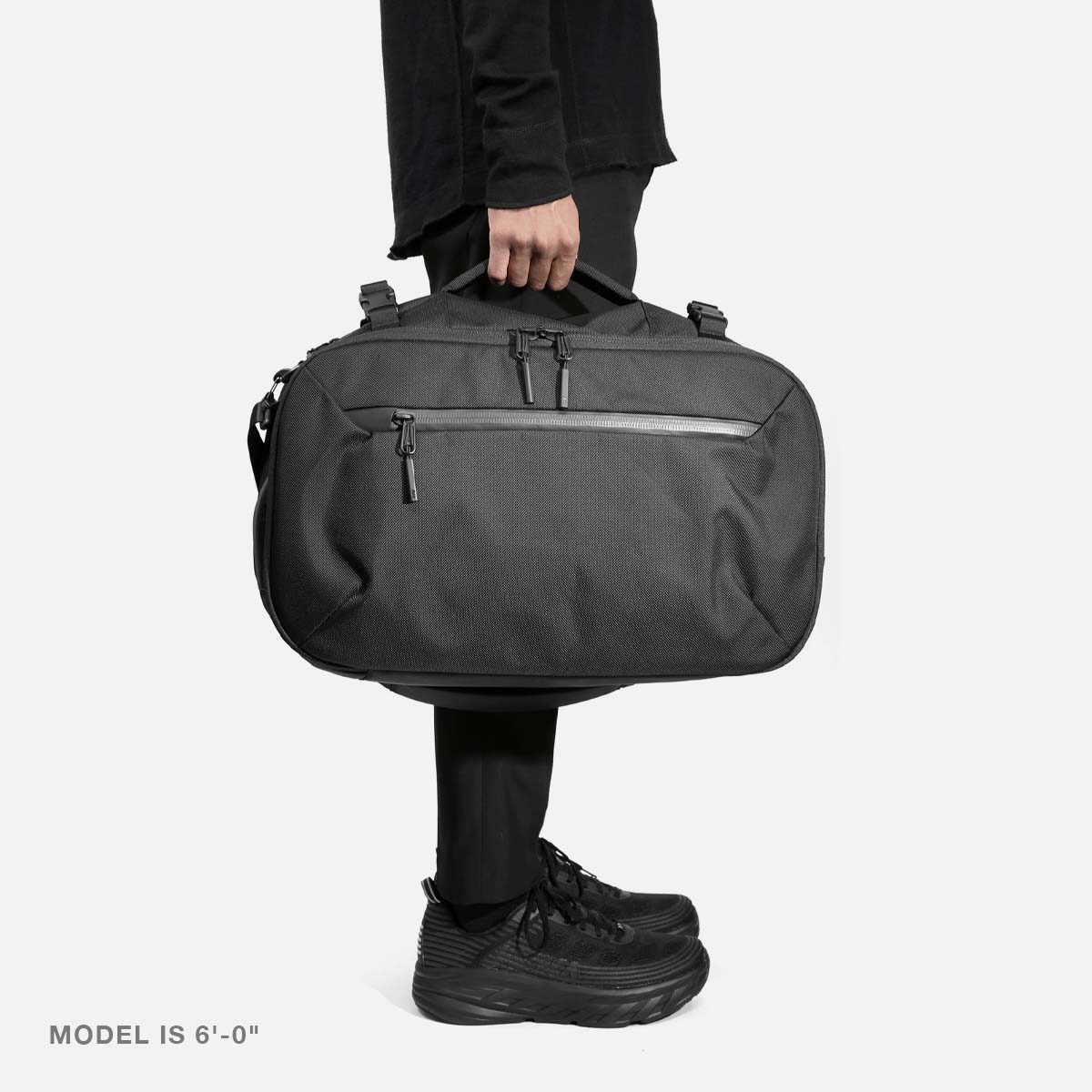 21014_travelduffel_black_model_m1.jpg