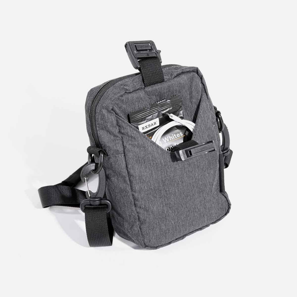 Front stash pocket with Fidlock® magnetic fastener for secure storage.