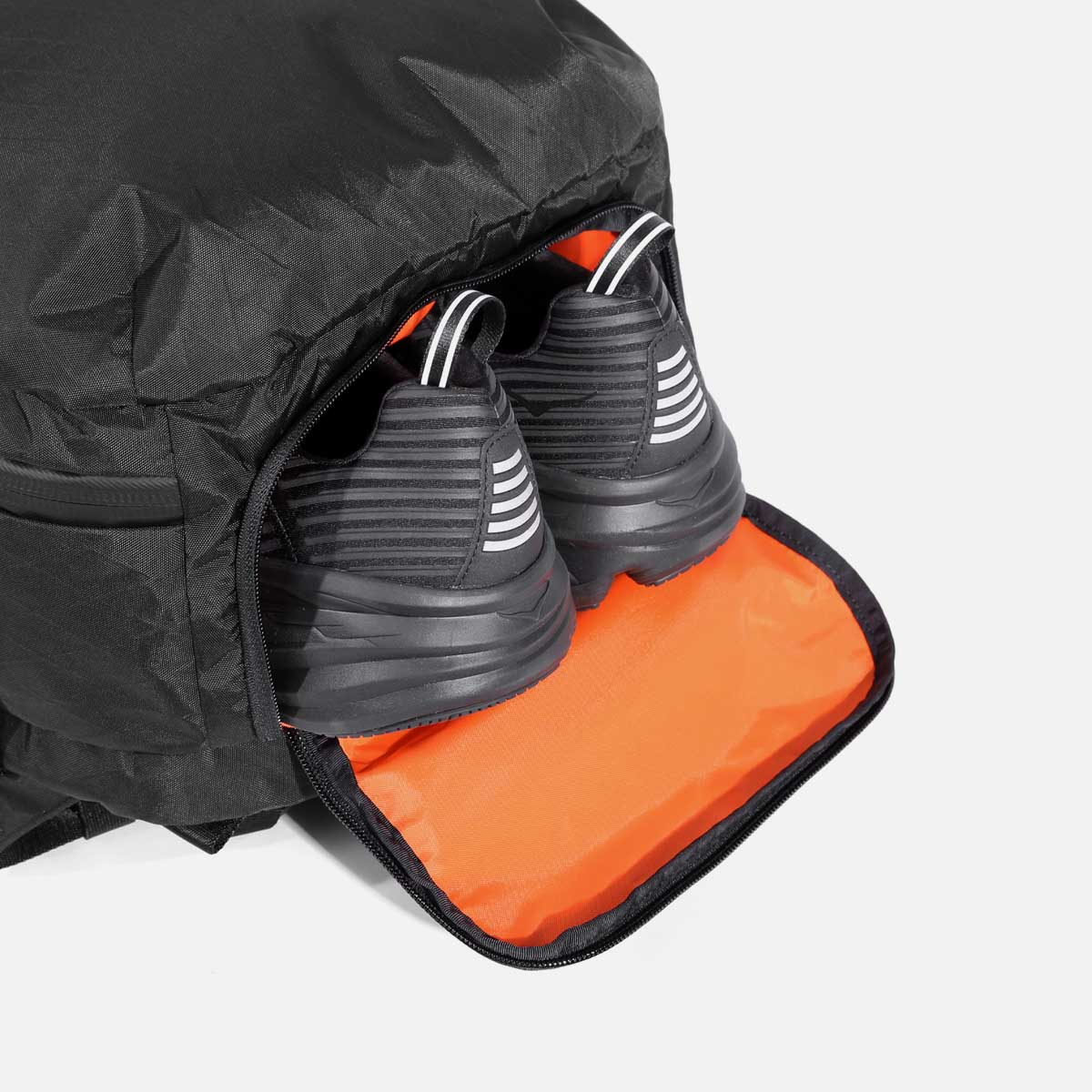Separate compartment for shoes or dirty clothes.