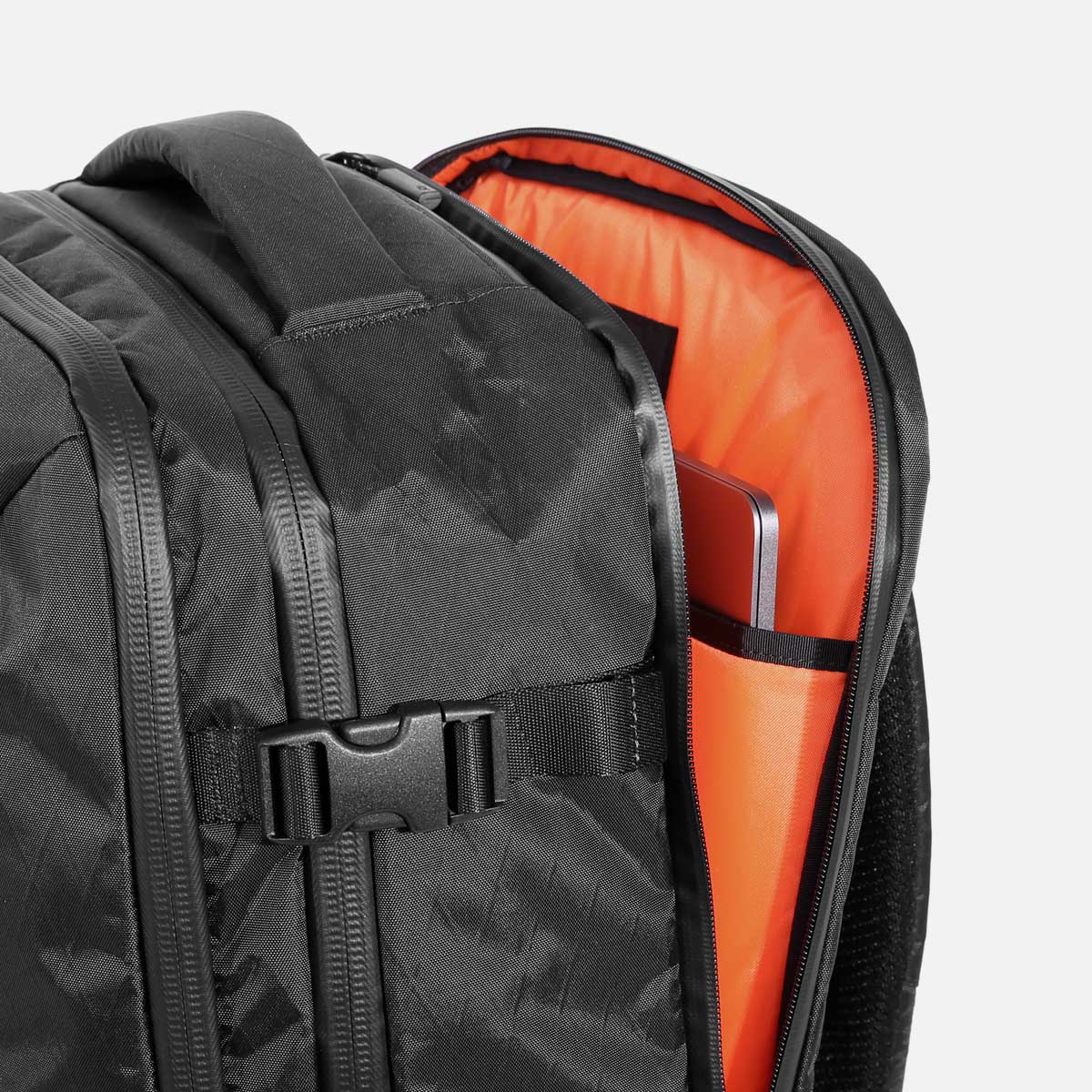 """Quick-access laptop pocket (fits up to 15.6"""" laptop) with YKK® AquaGuard® zippers."""