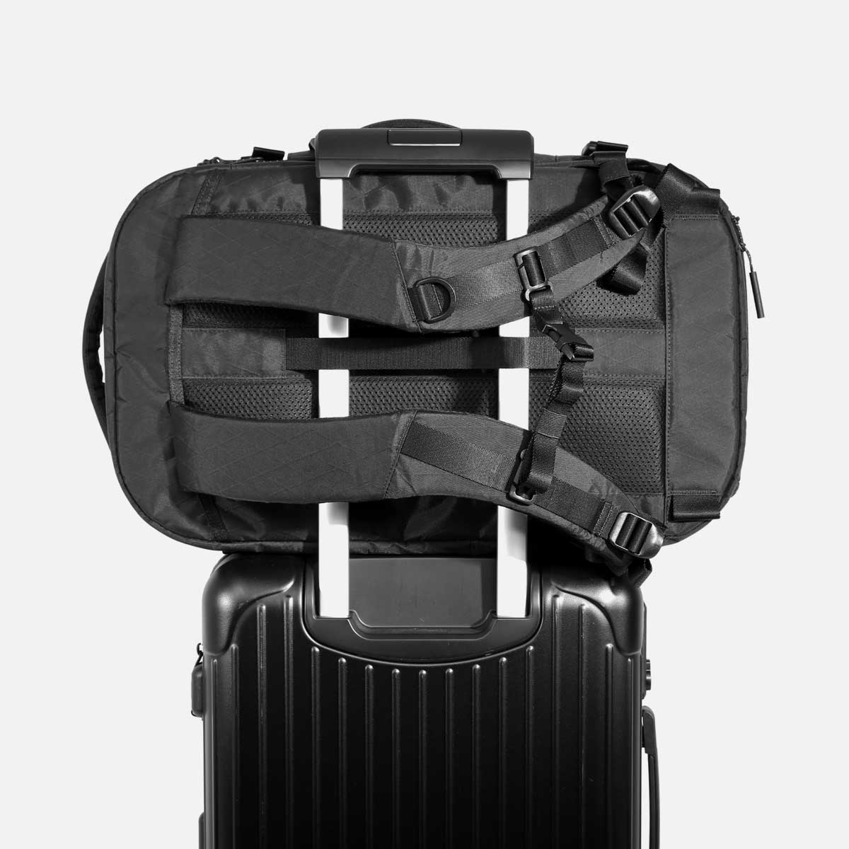 Luggage handle pass-through for convenient carry.