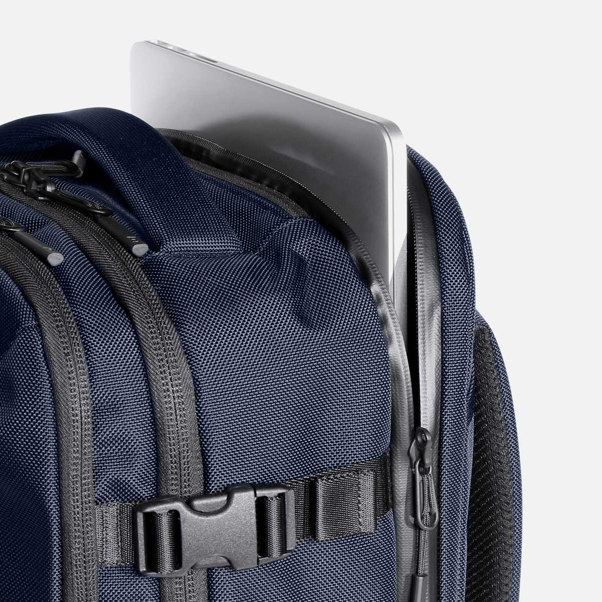 Quick access laptop pocket with padded base and YKK® AquaGuard® zippers.