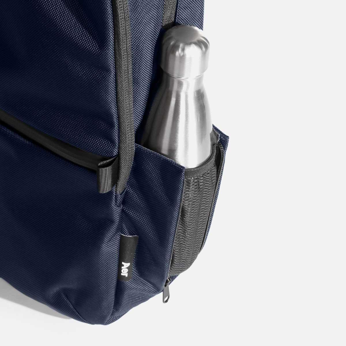 Expandable pocket for bottles or umbrellas.