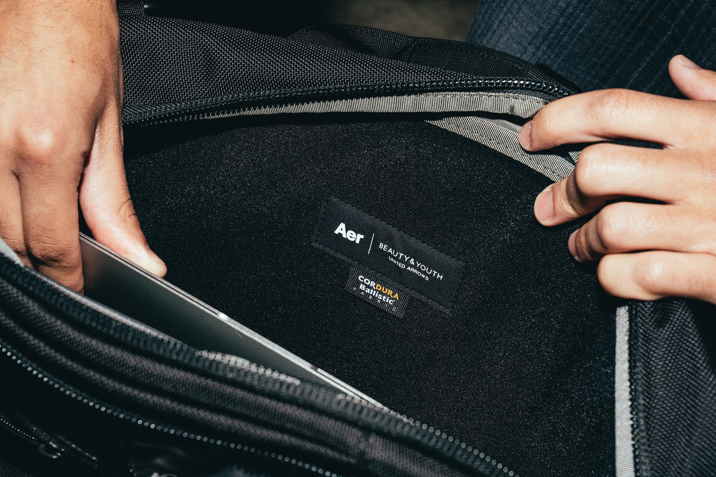 The laptop pocket features soft lining for additional protection.