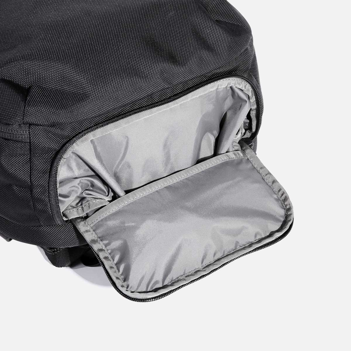 Stowable shoe pocket keeps excess fabric contained.
