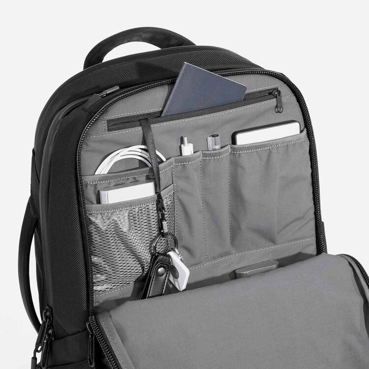 Smart organizational pockets lined with a soft woven fabric.