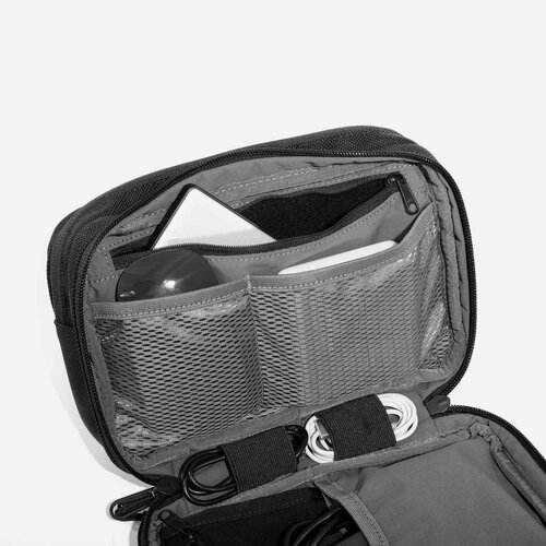 Interior device pocket with padded soft lining.