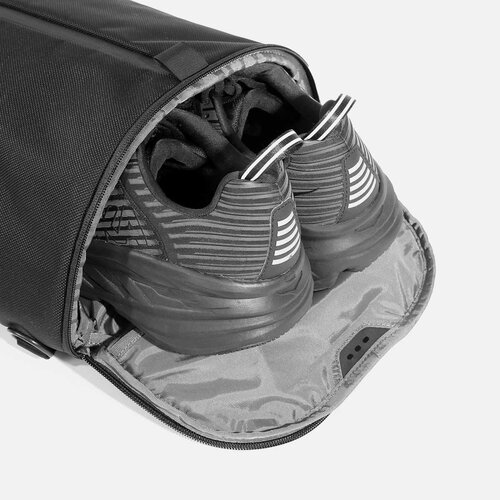 Ventilated shoe compartment with stowaway design.