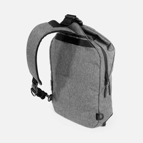 Padded shoulder strap adjusts for left or right shoulder use