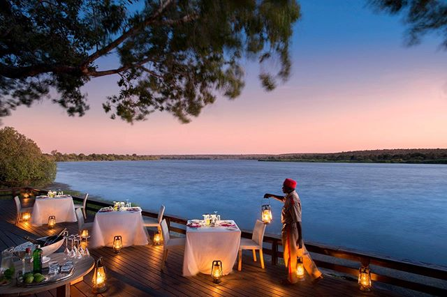 Royal Chundu @royalchundu is a serene property on the northern bank of the Zambezi River, separated from other camps and civilization by a series of rapids, ensuring privacy and calm. I recommend a 2-night stay at the end of your safari, as it will allow you to visit Victoria Falls and take in other activities. A must-do: canoe down the Zambezi with your guide and have a private picnic on an island. You can take helicopter flights over Victoria Falls, as the property has their own heli pad, but don't forget about the magical sunset cruises on the mighty Zambezi, the spa services or just chilling out on your veranda at your room. There are two camps to choose from, depending on what you are looking for. Their River Lodge is great for small groups and families and Island Lodge is more private and great for romantic getaways and honeymoons.  Chundu is all about community, as the relationship with the nearby communities is extremely strong and you will see why when you visit. Let us plan your next safari and we can include Royal Chundu in your itinerary or any of our other favorite properties.  Royal Chundu was recently awarded in the top 10 best in Africa by @cntraveler in their annual Reader's Choice Awards. Congratulations to Tina, Aggie and the rest of the team. Well done! ————————————————— @royalchundu   @cntraveler  #relaischateauxafrica ————————————————— #luxurysafari #safari #victoriafalls zambia #zambezi #relaischateauxafrica #andybiggssafaris #theglobalphotographer