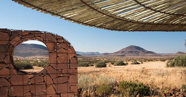 I am continuing my favorite places to stay in Africa and today's entry is a swing of the pendulum over to the other side of the luxury spectrum where the luxury is being in the most beautiful of locations where nature itself is the luxury. Etendeka Mountain Camp is a small footprint setup in the Etendeka plateau in the Kaokoveld of northern Namibia. The area is 400 square kilometers of unspoiled wilderness where you can do game drives and nature walks. There are unique species of vegetation that will capture your attention but so will the sunsets, wildlife and stories from Dennis Liebenberg, the founder and manager. Dennis is the reason for visiting, as he has a deep love for the land and the communities. Etendeka Mountain Camp is the definition of being off the grid and if you are making your way to Namibia and want something different this is the place for you. @big_sky_lodges_namibia #etendekamountaincamp #namibia #selfdrive #overlandnamibia