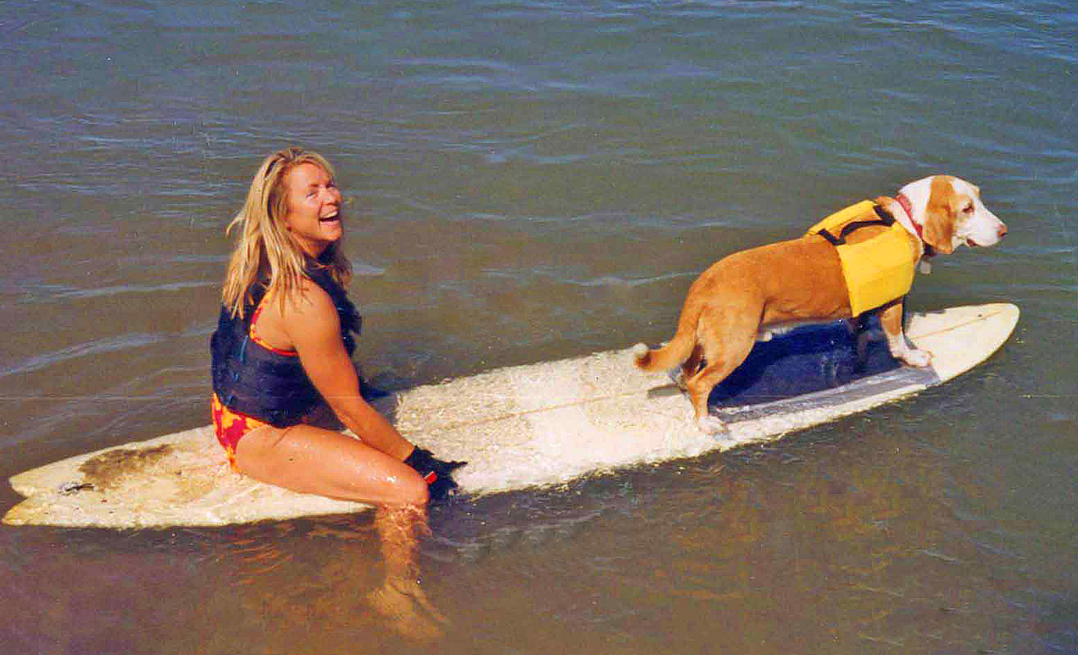 Howdy and me, surfing on the Colorado River, circa 2002.   Photo: (c) Barb Ayers, DogDiary.org