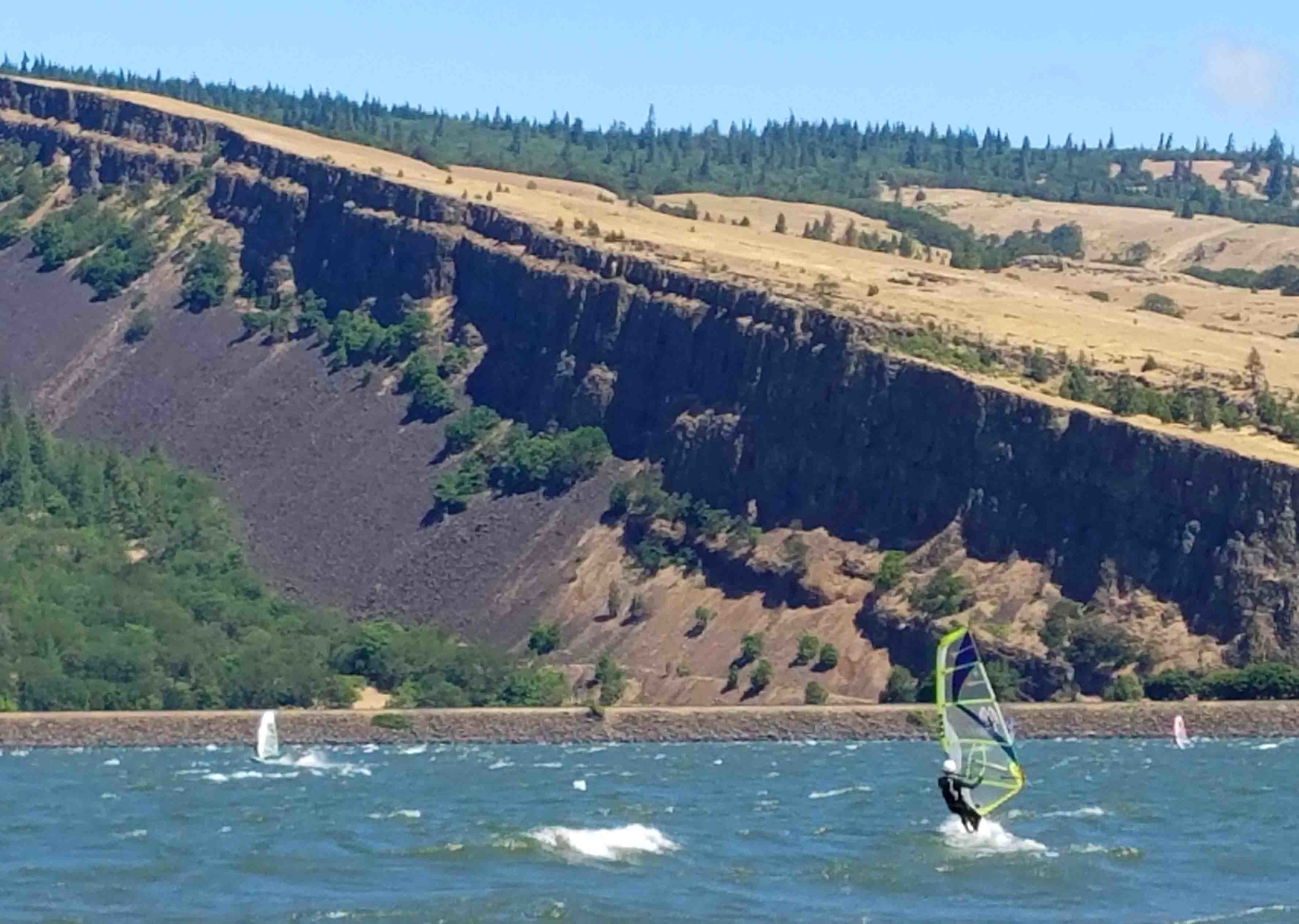 Big Wind day at Mosier's Rock Creek beach. Sailing over powered on a 3.2 last weekend. Wind is too big for Doodle, so he's hanging on shore. Photo: (c) Barb Ayers, DogDiary.org