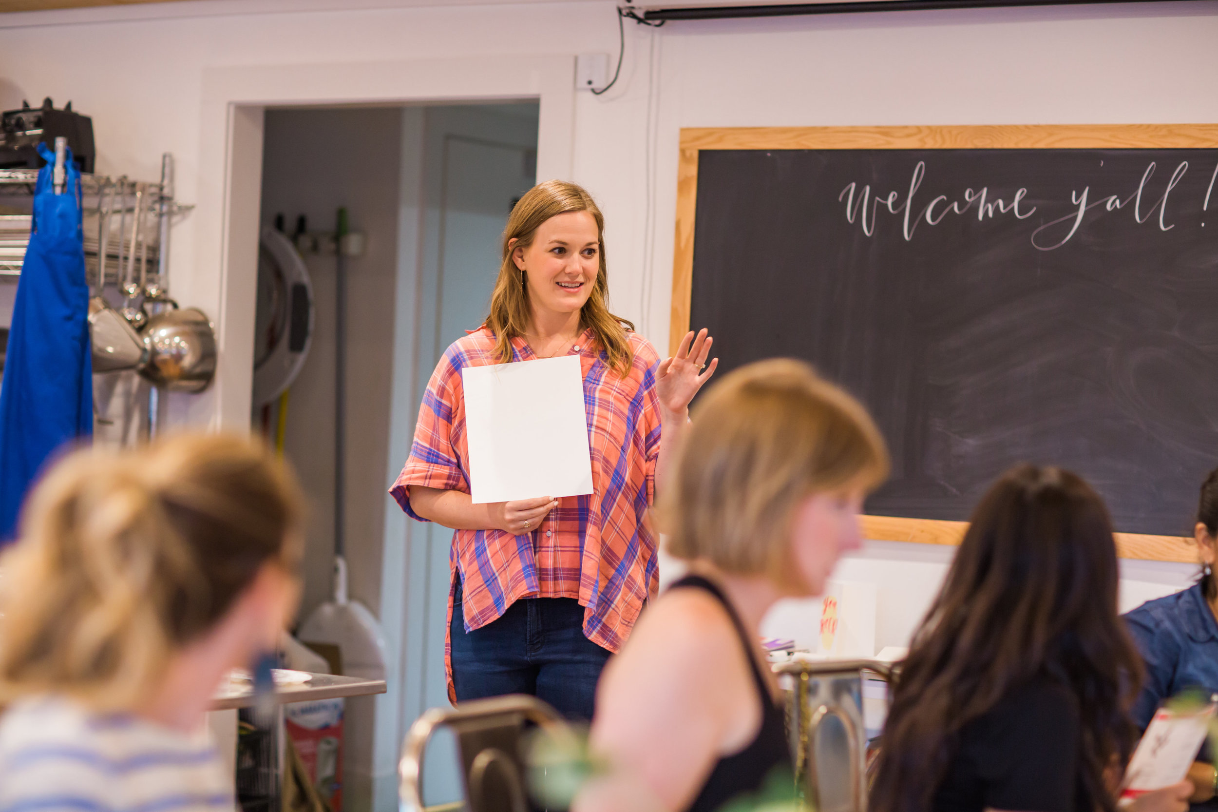 Natalie Coulter introducing brush lettering to guests. Photo credit: Melissa Lewis Photography