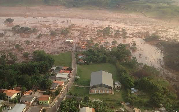 A dozen killed and homes are flooded as a Dam bursts in Mariana, Brazil   Photo: Mariana Fire Department