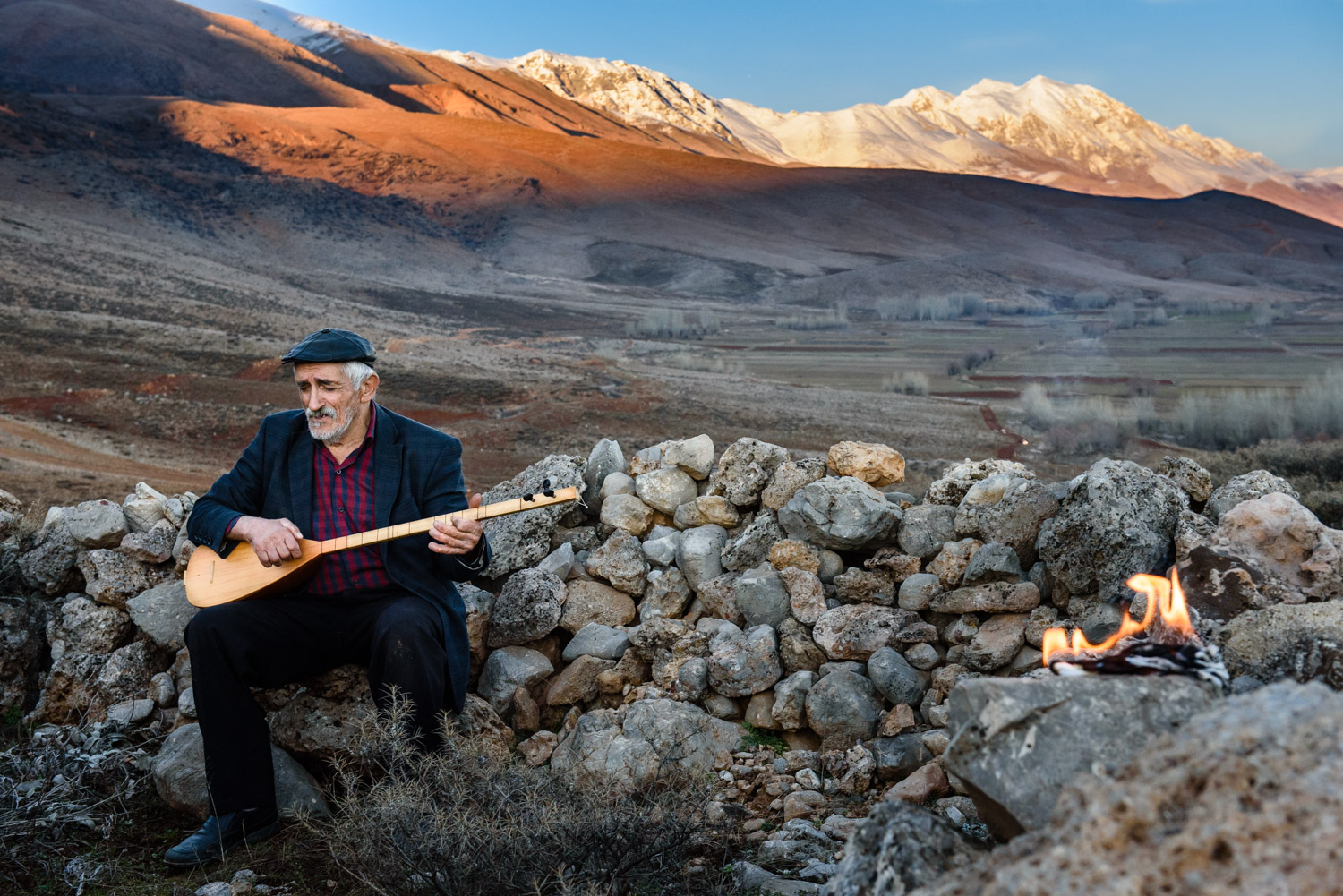 The Zeynal Dede, a highly respected Alevi religious leader, performs a prayer ceremony on a sacred hill in the Munzur Valley.