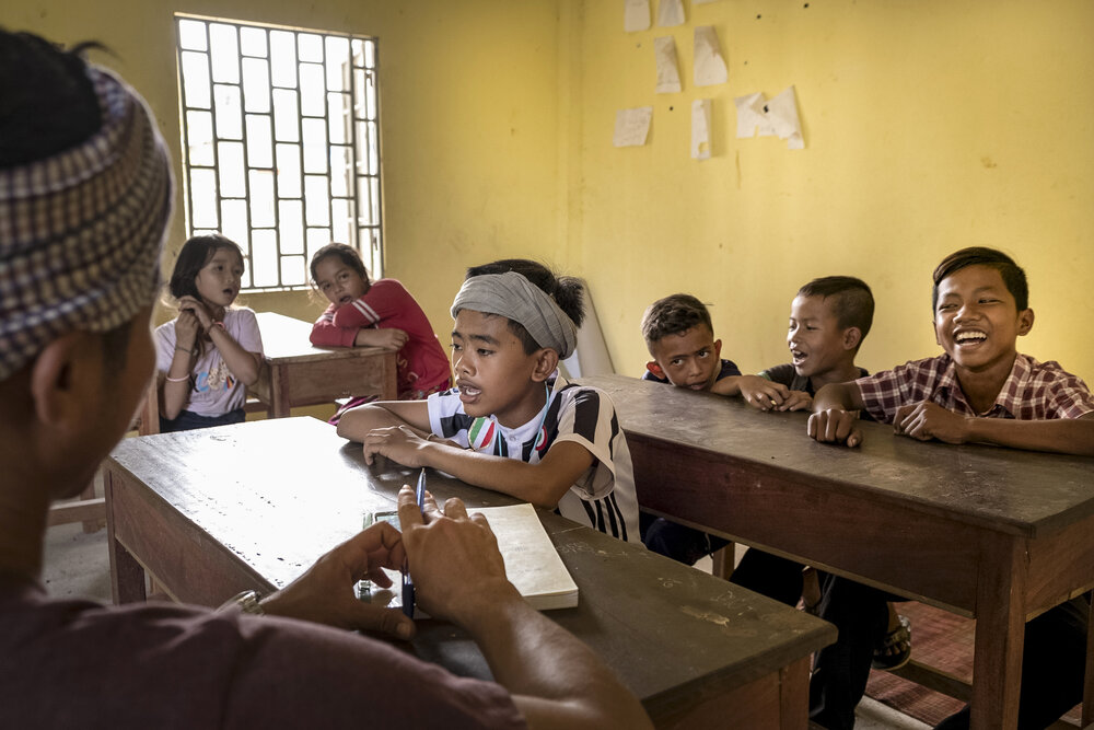 Imam San have made efforts to revive their traditional language over recent years. In 2004, Leb Ke, a Cham language specialist, founded a Cham language school. Children learn how to write using the Cham alphabet and sing Cham songs, as pictured here.
