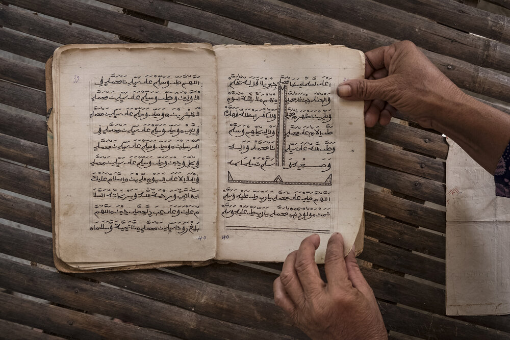 During the Khmer Rouge, some Imam San sacred texts were buried to save them from being destroyed and later unearthed. Over 90,000 Cham (including both Imam San and 'Modern') perished during the genocide.