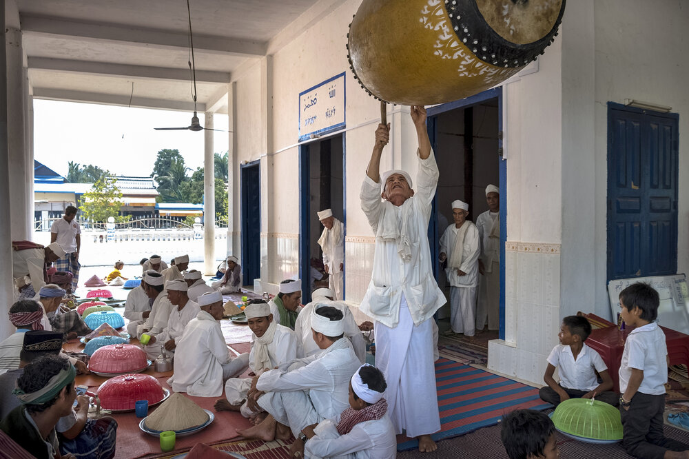 An Imam San imam beats a drum to announce the call to prayer. The Imam San pray only once a week, as compared to the Modern Cham, who pray five times a day.