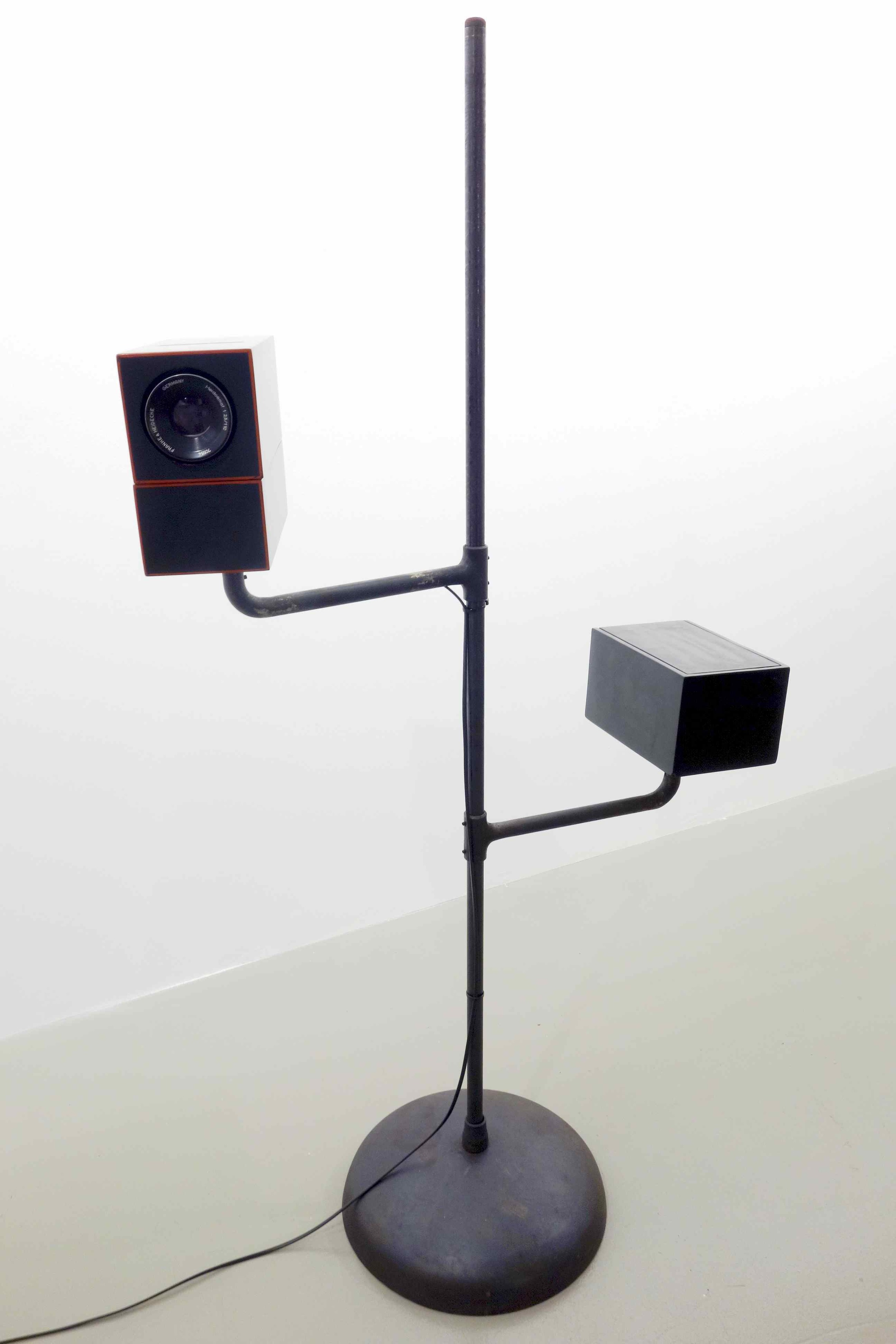 Lacquerscope #2  2014 Resin composite medium format (50mm) projector. Iron stand, base and swivel arms, 174.5 x 102 cm