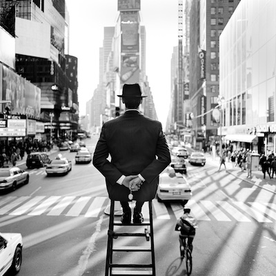 """Man on Ladder in Times Square, New York, NY  1999 Silver gelatin print 15.5 x 15.5"""" (image) 28 x 32"""" (mount)"""