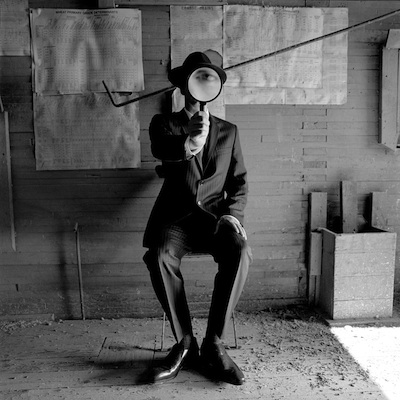 """Colin with Magnifying Glass, Alberta, Canada  2004 Silver gelatin print 10.5 x 10.5"""" (image) 22 x 26"""" (mount)"""