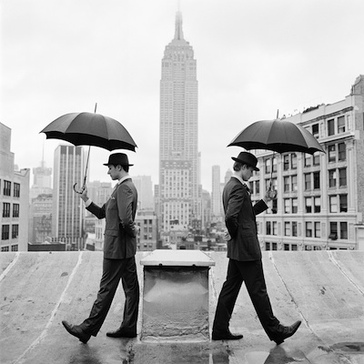 "Reed and Nathan with Umbrellas on Rooftop, New York, NY  2011 Silver gelatin print 15.5 x 15.5"" (image) 28 x 22"" (mount)"