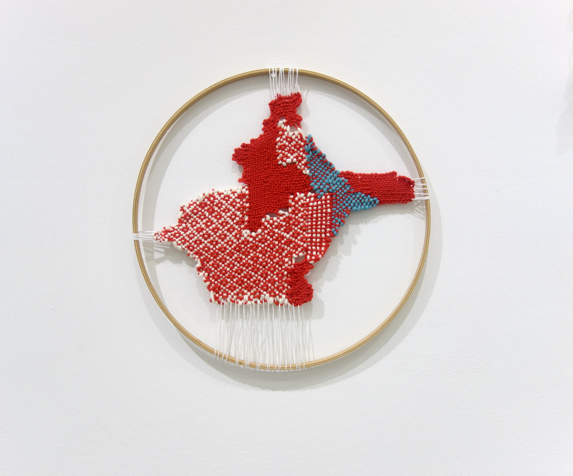 Izziyana Suhaimi, Cross Section of Bone II, 2015, Cotton thread and wool; woven on wooden hoop, Ø36 cm.jpg