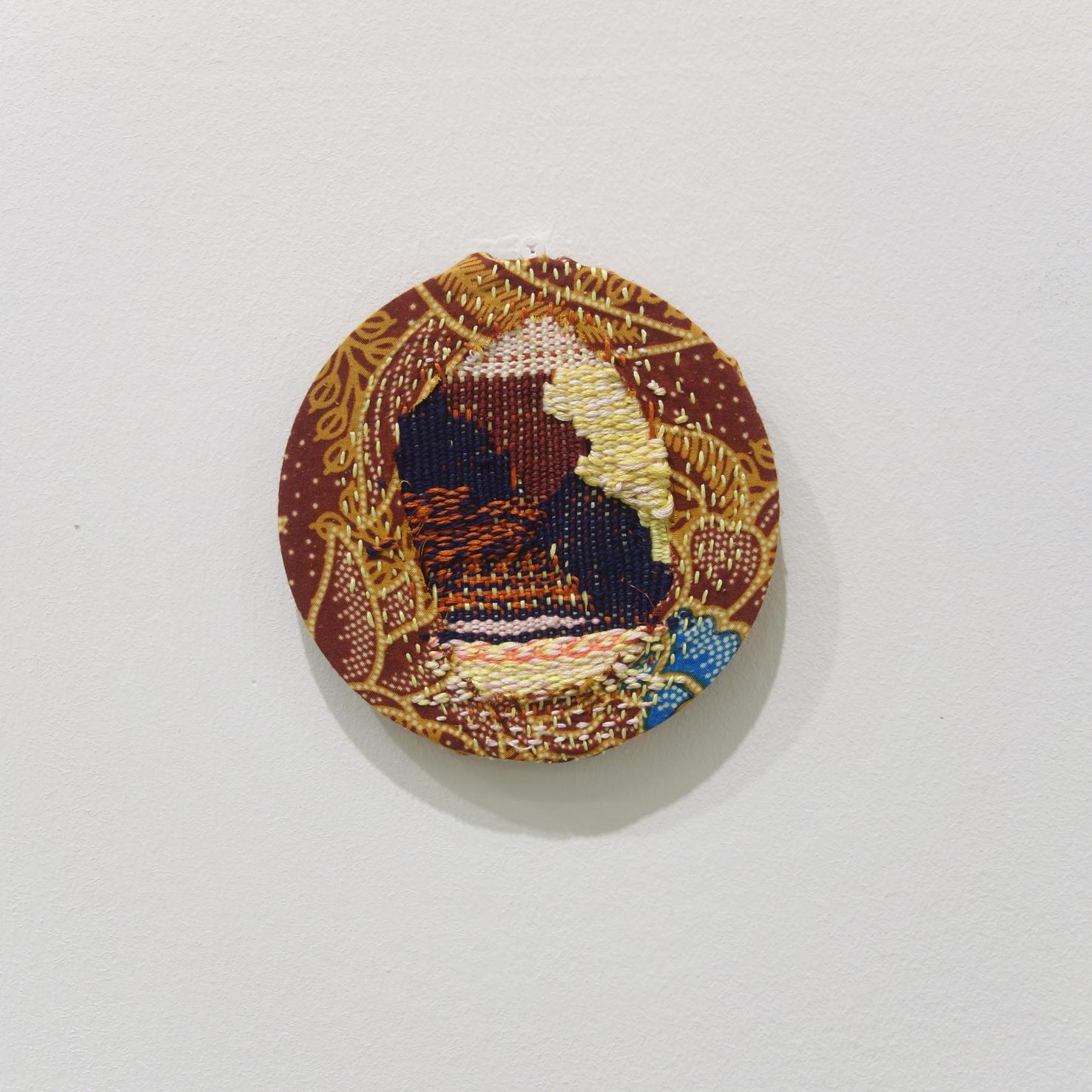 Izziyana Suhaimi  Cross Section of Bone V  2015 Woven cotton thread darned on found Batik; wooden hoop Ø13 cm