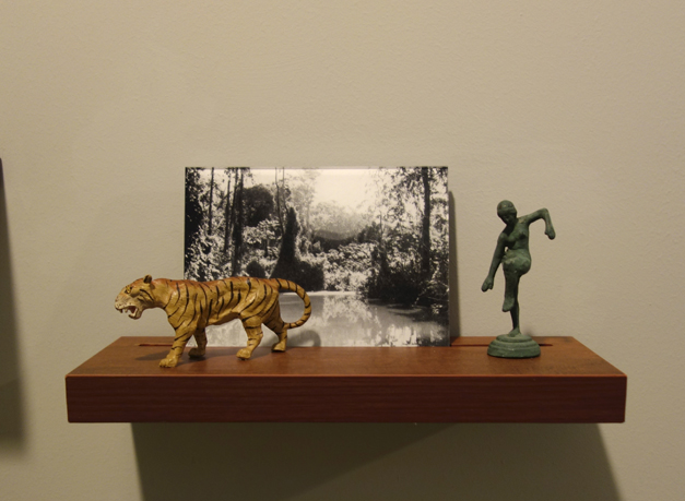Donna ONG  Postcards from the Tropics (iii)  2016 Diasec print, wooden shelf, and tropical souvenirs (clay orchid on wood, antique ceramic parrot and vintage miniature ceramic birds Dimensions variable