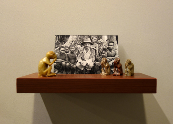 Donna ONG  Postcards from the Tropics (viii)  2016 Diasec print, wooden shelf, and tropical souvenirs (stone monkeys) Dimensions variable