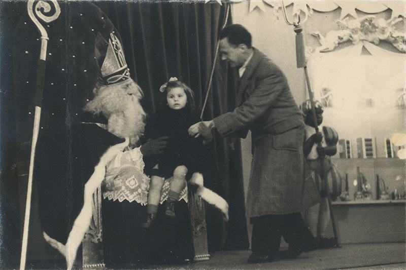 My Aunt as a child sitting on Sinterklaas's lap during the late 1940's.