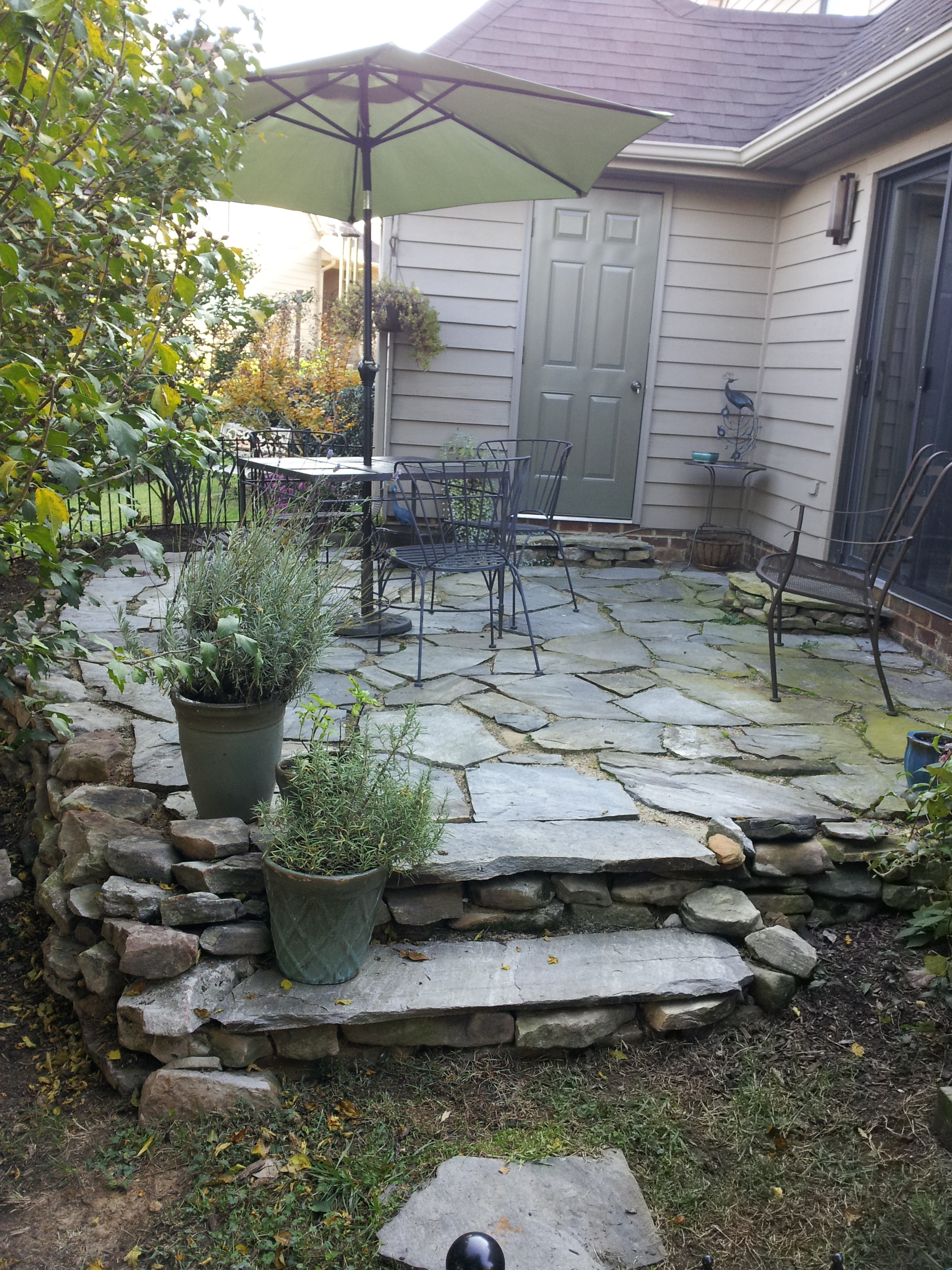Stone terrace designed to replace a small deck in Mill Creek.