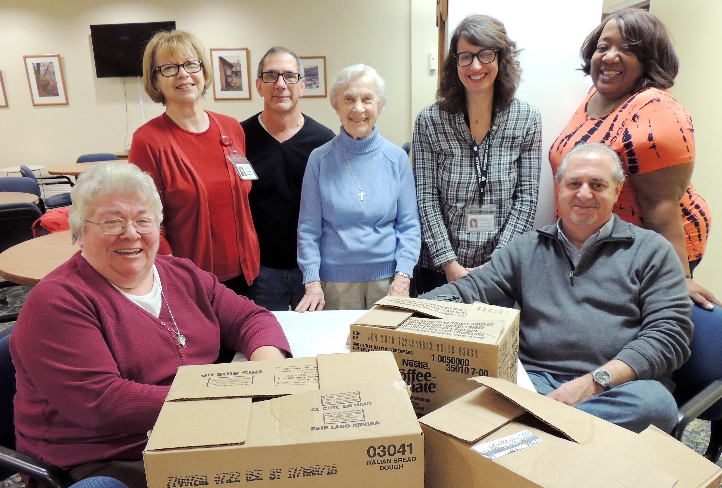 Sister Rebecca Nolan, OP; Linda Burkett; Joe Solomon; Sister Lucille Holtz, RSM; Caterina Natalia; Linda Marlow; and Frank A. Borelli prepared 100 sandwiches for distribution to persons who are experiencing homelessness by outreach teams at Pittsburgh Mercy's Operation Safety Net (Photo © 2018 by Micaela Young for Pittsburgh Mercy. Used with permission.)