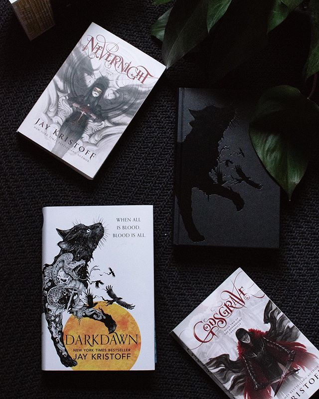 "Do you prefer your hero's to be morally grey or more stereotypical in nature? ⠀ .⠀ As I've gotten older, I find complex, morally grey hero characters like Mia to be more compelling and interesting. ⠀ .⠀ (Omg omg omg guys my UK Edition fo Darkdawn arrived today and I'm squealing with joy- it's so pretty 😍) ⠀ .⠀ #bookqueenssept19 Professor Quirrell : two-faced characters ⠀ #bookravenssept19 deckled edges or sprayed edges (this is tough, and depends on the book, but I think deckled) ⠀ #bookreadhappyhour Warriors come out to plaaaay! | Warriors ⠀ #wildadventuresinhogwarts McGonagall : favorite mentor characters (Mister Kindly and The Disreputable Dog from the Old Kingdom Trilogy were both great, if unorthodox, mentors)  #cozyinseptember19 sweater weather (today is the first time I've felt slightly chilled in shorts - sweater weather is starting to arrive here in Seattle) ⠀ #darkdawnalong ""If I were going to name my blade,"" Mia said thoughtfully, ""I'd call it 'Fluffy.'"" (Spell your name with books- the top corner had a book stack that spelled my name but i forgot to factor for the IG crop so... whoops 🙈) ⠀ #betterreadschallenge 238/365"
