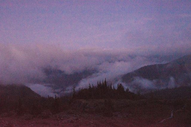 {dusk} . On the return trek from a foggy hike to the Mt. Fremont Lookout station, the fog lifted, allowing us one last gorgeous glimpse of the mountains before they faded into the night.