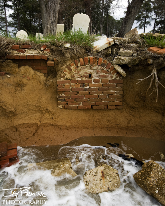 A cemetery dating back to the late 1700's succumbs to erosion. Dorchester County, Maryland.