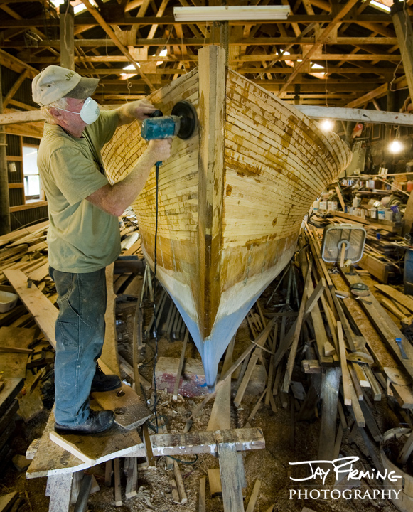 Millard Littlepage sands the bow of his wooden boat. Dorchester County, MD. September 2014