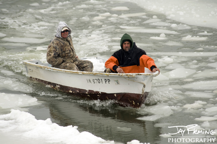 Tangier Island Watermen check their boats after a week of solid ice. February 2015