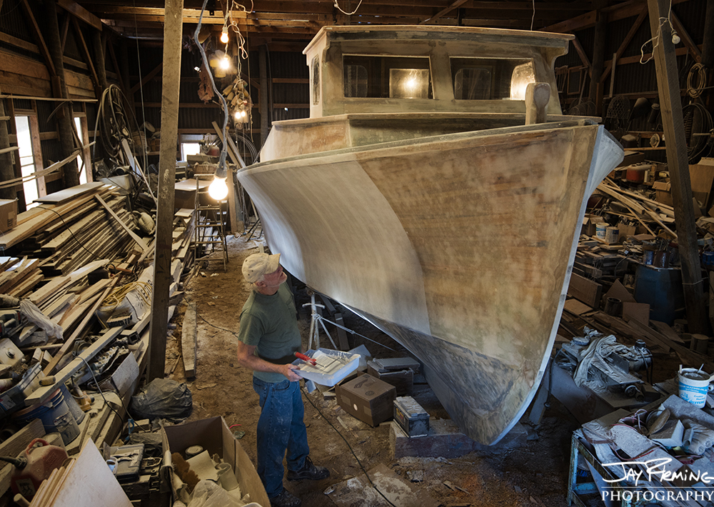 After the strip planked boat was coated with fiberglass, multiple coats of primer paint were added before the top coats of paint