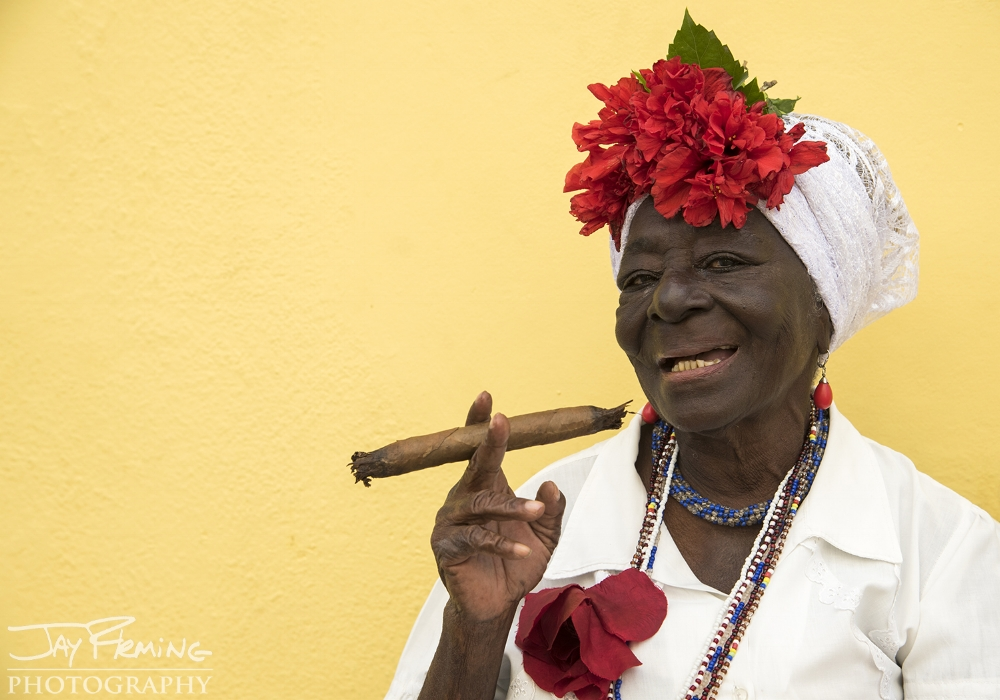 Cuban woman dressed in all white - traditional clothing for people practicing Santeria