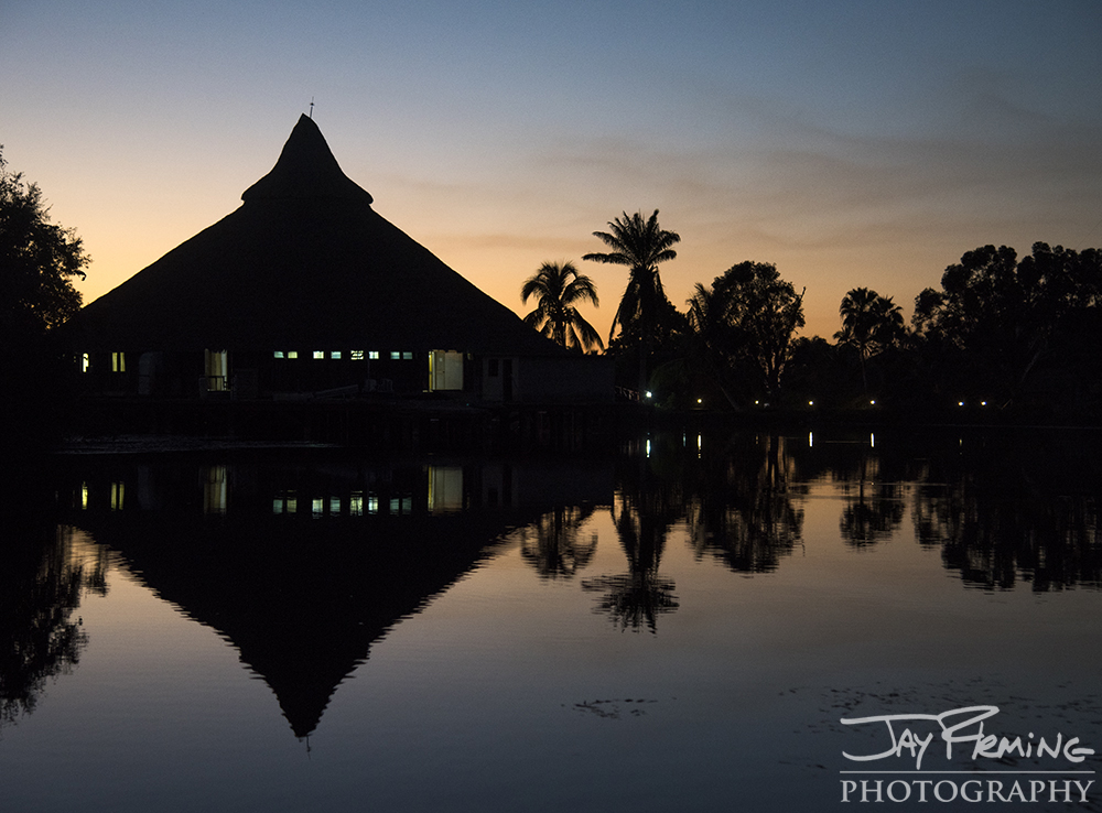 Sunset silhouettes the main building in the Boca Guama complex.