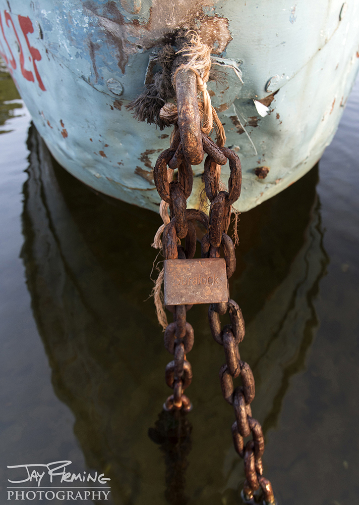 Padlocks on boats prevent the vessels from being stolen and taken out to sea. Since the rise of communism in Cuba in the early 1960's, many Cubans have fled the country.